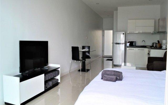 Отель Coconut Bay Club Suite 302 Ланта комната для гостей