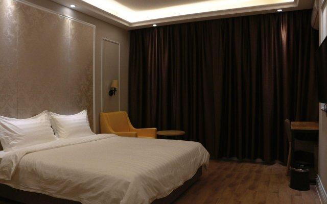 Solo Hotel Shuanglong Store комната для гостей