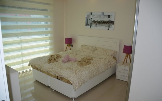 Отель Luxury Apt in Konak Sea Side with a Sea front view and a private beach комната для гостей