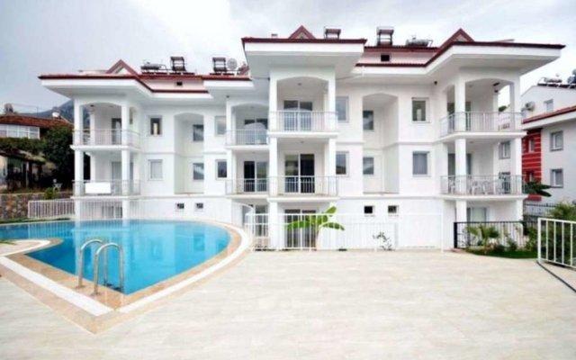 Infinity Olympia Apartments Турция, Олудениз - отзывы, цены и фото номеров - забронировать отель Infinity Olympia Apartments онлайн вид на фасад