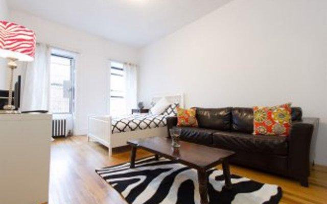 Апартаменты Times Square Studio комната для гостей