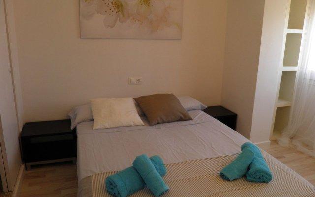 Отель Suitur Atico Playa Dorada Испания, Калафель - отзывы, цены и фото номеров - забронировать отель Suitur Atico Playa Dorada онлайн комната для гостей