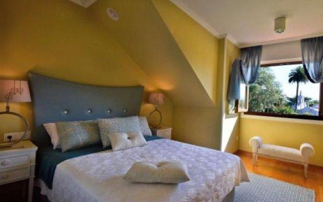 Отель Chalet en la Toja комната для гостей