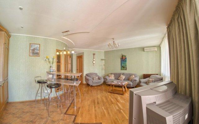 Апартаменты Apple на Полтавской комната для гостей