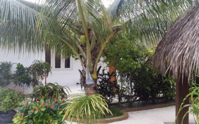 Отель Asuruma View Guest House Ханимаду вид на фасад