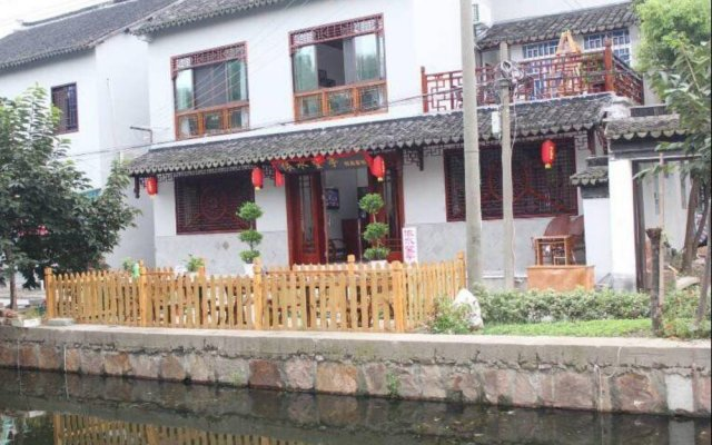 Отель Zhouzhuang Wangjiangting Hostel Китай, Сучжоу - отзывы, цены и фото номеров - забронировать отель Zhouzhuang Wangjiangting Hostel онлайн вид на фасад