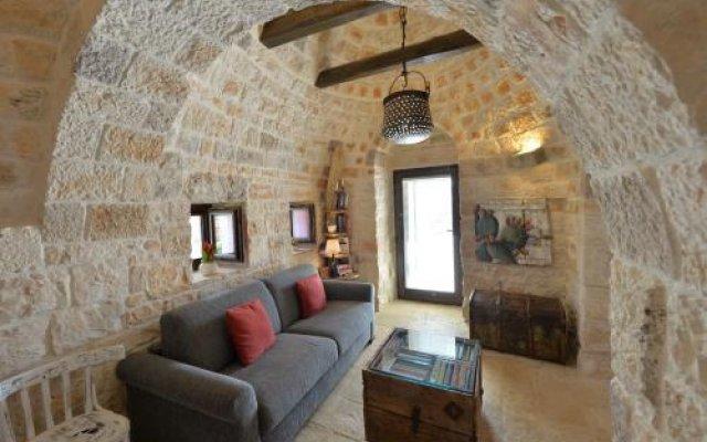 Отель Trulli Monte del Sale Альберобелло комната для гостей