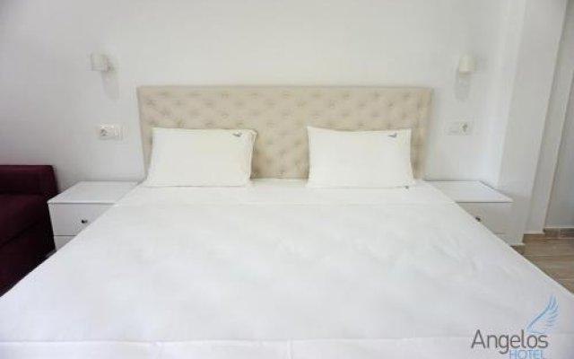 Angelos Hotel Ситония комната для гостей