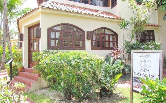 Отель Los Corales Villas Ocean Front Доминикана, Пунта Кана - отзывы, цены и фото номеров - забронировать отель Los Corales Villas Ocean Front онлайн вид на фасад