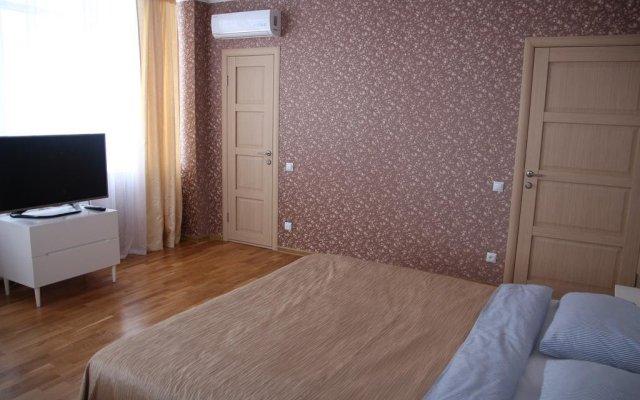 Апартаменты Олимп комната для гостей