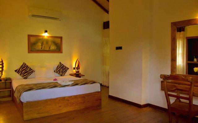 Отель Crown Monarch Diyamankada Nature Resort комната для гостей