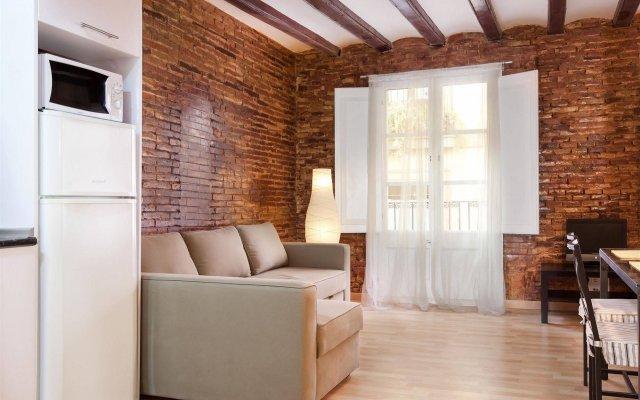 Апартаменты El Born Apartment комната для гостей