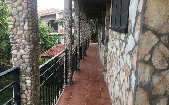 Апартаменты Legassi Gardens Apartments вид на фасад