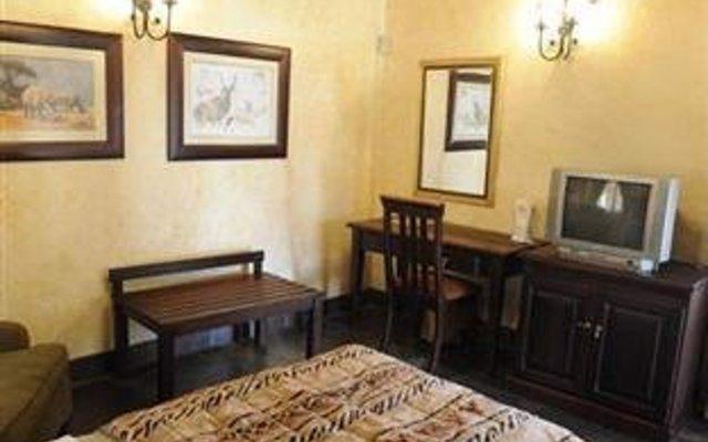 Отель The Big Five Lodge Габороне удобства в номере