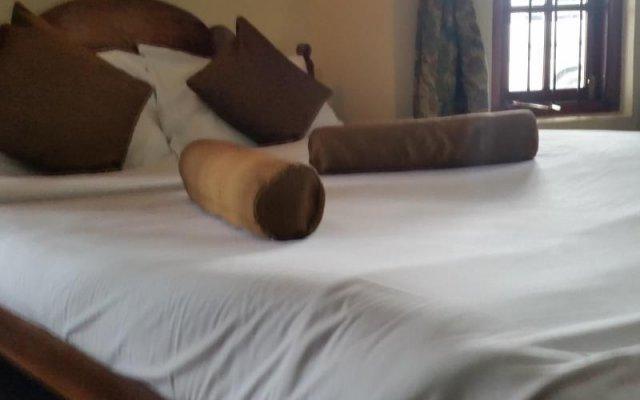 Отель Nuwara Eliya Colonial Bungalow комната для гостей