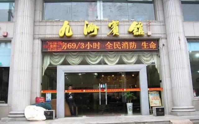 Wuhan Jiuzhou Hotel вид на фасад