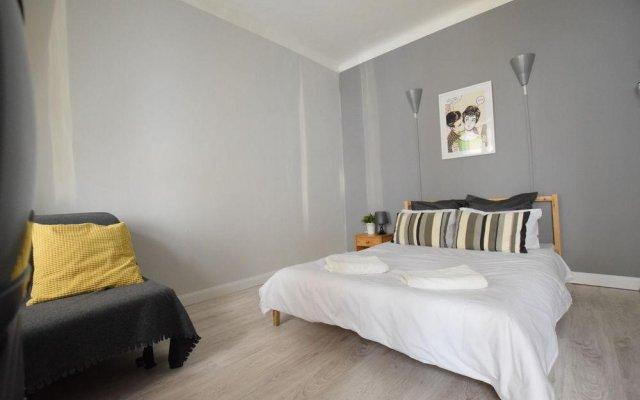 Апартаменты Hi5 Apartments - Basilica комната для гостей