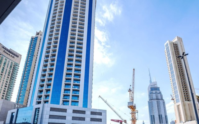 Апартаменты One Perfect Stay Studio Burj Al Nujoom вид на фасад