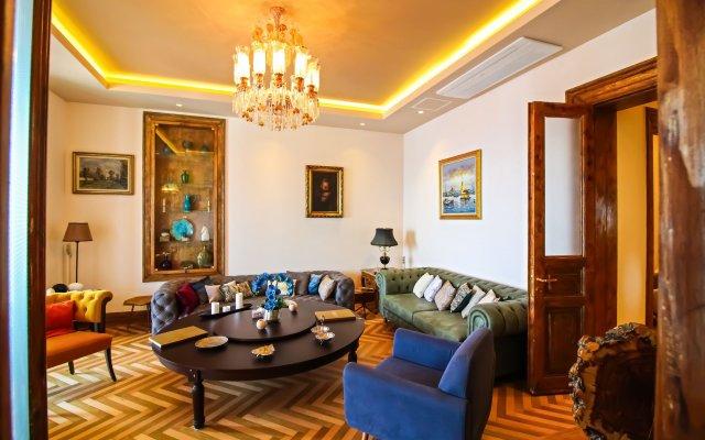 Отель Maroon Residence комната для гостей