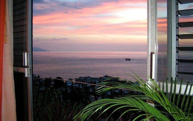 Отель Suites La Siesta Пуэрто-Вальярта комната для гостей