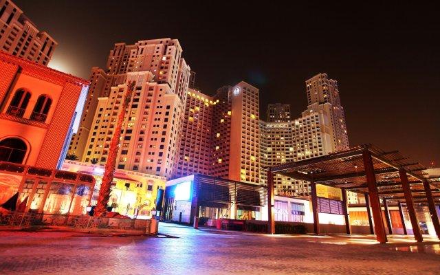 Отель Amwaj Rotana, Jumeirah Beach - Dubai вид на фасад
