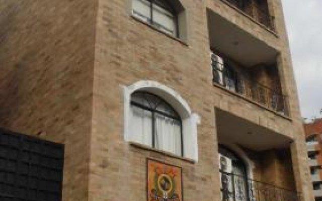 Отель Suites House Centenario Колумбия, Кали - отзывы, цены и фото номеров - забронировать отель Suites House Centenario онлайн вид на фасад