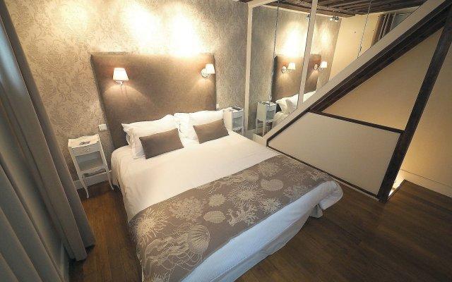 Отель Louvre Parisian Франция, Париж - отзывы, цены и фото номеров - забронировать отель Louvre Parisian онлайн комната для гостей