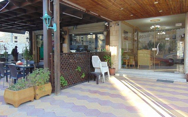 Al-Nujoom Hotel Suites вид на фасад