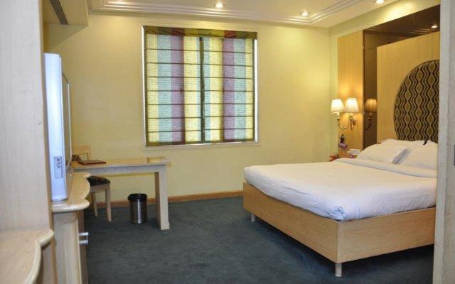 Hotel Grand International комната для гостей