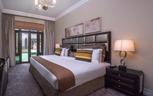 Апартаменты Downtown Al Bahar Apartments Дубай комната для гостей