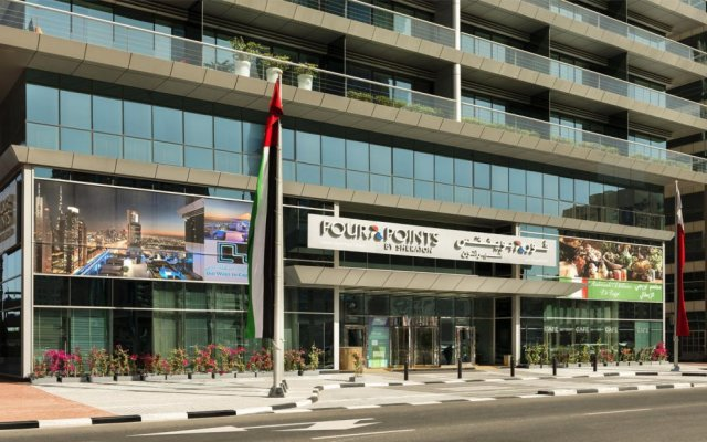 Отель Four Points by Sheraton Sheikh Zayed Road, Dubai Дубай вид на фасад