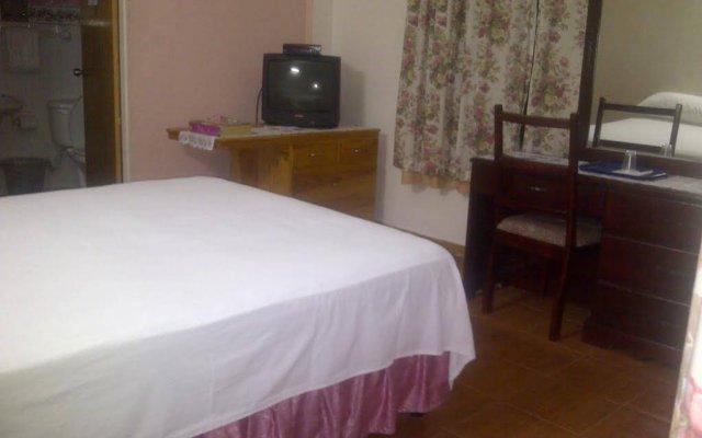 Отель Palm Bay Guest House & Restaurant Ямайка, Монтего-Бей - отзывы, цены и фото номеров - забронировать отель Palm Bay Guest House & Restaurant онлайн комната для гостей