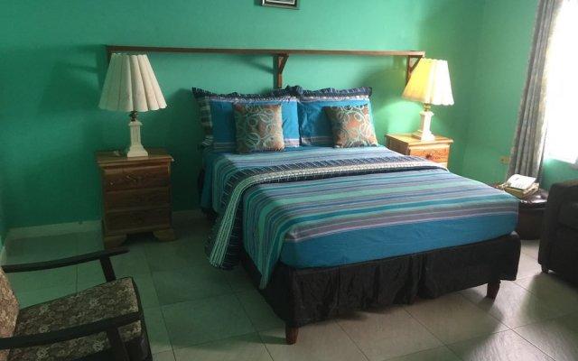 Отель Sunset Beach Studio At Montego Bay Club Resort Ямайка, Монтего-Бей - отзывы, цены и фото номеров - забронировать отель Sunset Beach Studio At Montego Bay Club Resort онлайн комната для гостей