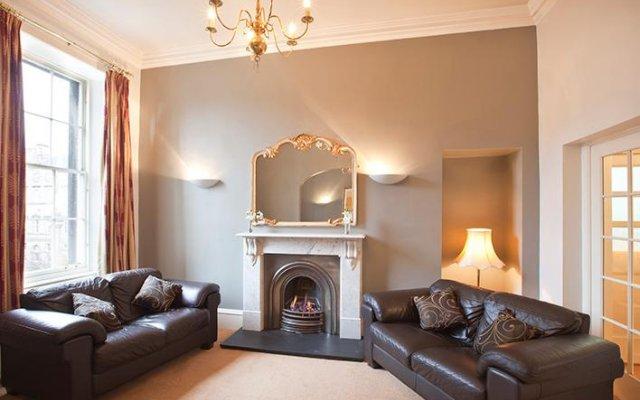 Апартаменты Greyfriars Apartments - Parliament Square Эдинбург комната для гостей