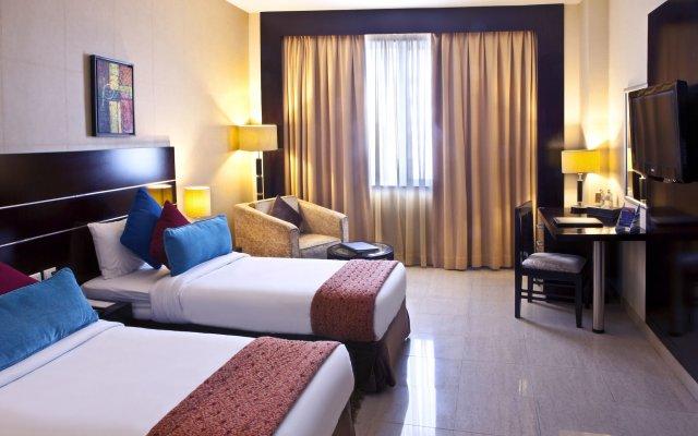 Отель Landmark Riqqa Дубай комната для гостей