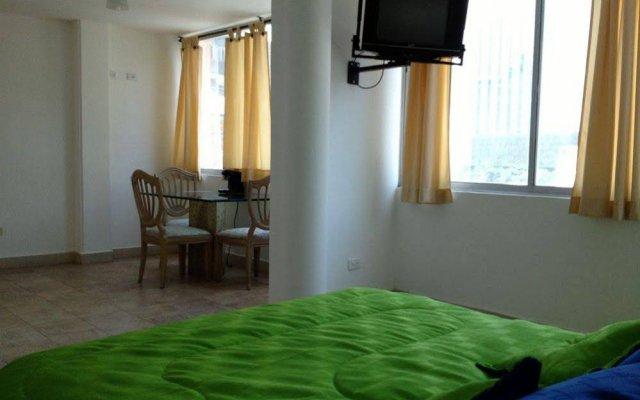 Отель Ayenda 1404 Konfortinn Колумбия, Кали - отзывы, цены и фото номеров - забронировать отель Ayenda 1404 Konfortinn онлайн комната для гостей