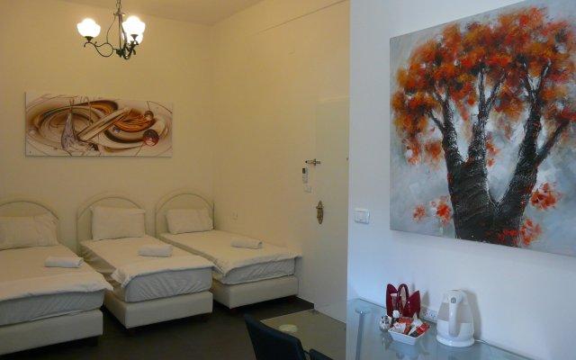 Апартаменты Loui M Apartments Хайфа комната для гостей