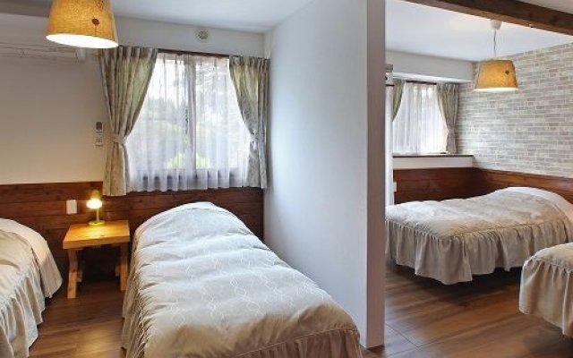 Отель Pension Orange Beer Япония, Минамиогуни - отзывы, цены и фото номеров - забронировать отель Pension Orange Beer онлайн комната для гостей