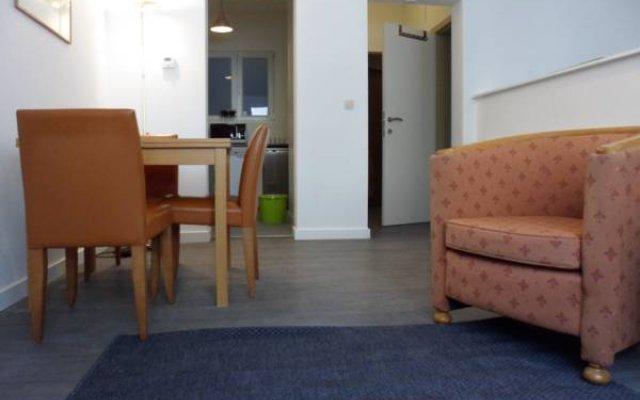 Отель Orange Cannelle Apartments - Hotel de Ville Бельгия, Брюссель - отзывы, цены и фото номеров - забронировать отель Orange Cannelle Apartments - Hotel de Ville онлайн комната для гостей