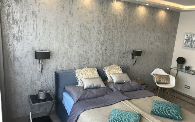 Апартаменты Dfive Apartments - Danube Corso комната для гостей