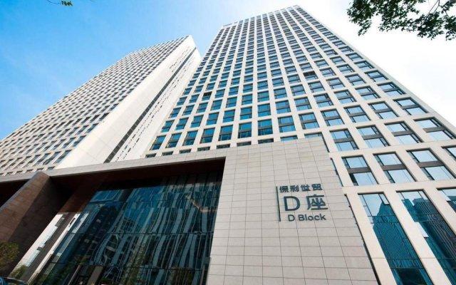 Отель Yishang Baoli Shimao International Apartment Китай, Гуанчжоу - отзывы, цены и фото номеров - забронировать отель Yishang Baoli Shimao International Apartment онлайн вид на фасад