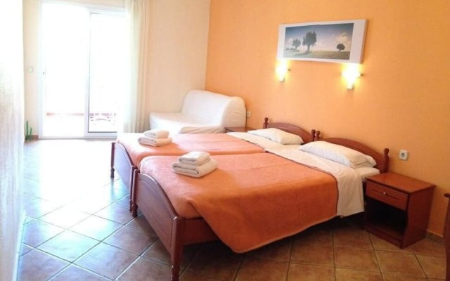 Отель Aloni Пефкохори комната для гостей
