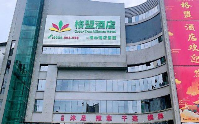 Gangxin Business Hotel вид на фасад