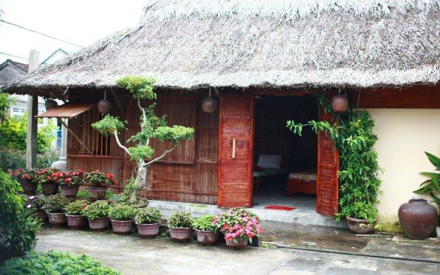 Гостевой Дом Petunia Garden Homestay вид на фасад