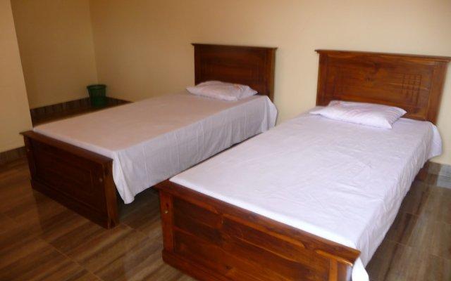 Отель Palugaha Pilgrim Resort комната для гостей