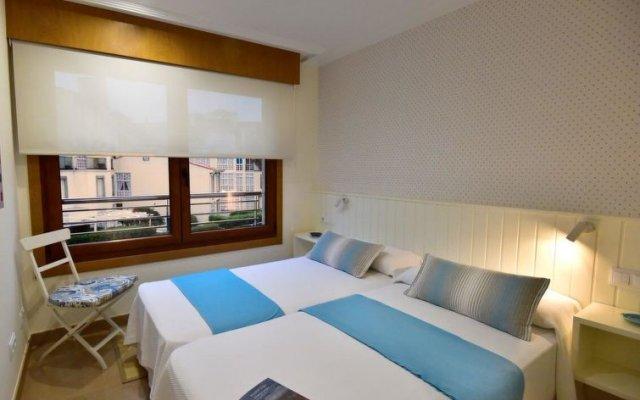 Отель Piso en Isla de la Toja Испания, Эль-Грове - отзывы, цены и фото номеров - забронировать отель Piso en Isla de la Toja онлайн комната для гостей