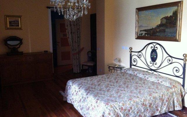Отель Villa Toscanini Стреза комната для гостей