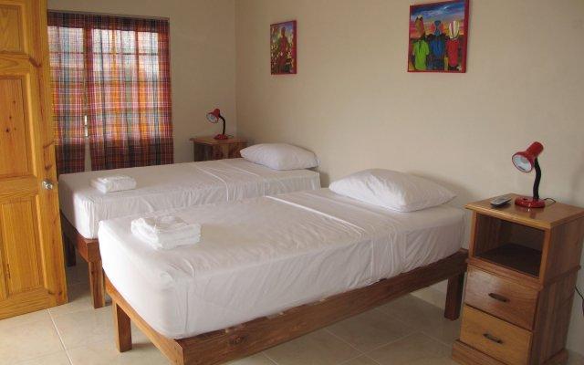 Отель Jack Sprat Shack Ямайка, Треже-Бич - отзывы, цены и фото номеров - забронировать отель Jack Sprat Shack онлайн комната для гостей