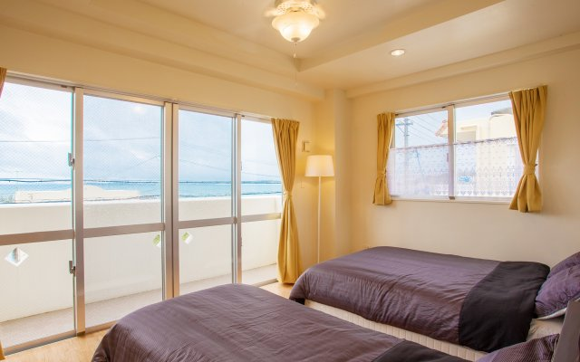 Отель Kariyushi Condominium Resort Kin Beach Side House Gracia Центр Окинавы комната для гостей