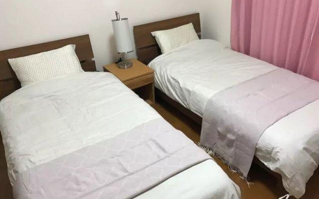 Отель Guest House air one Фукуока комната для гостей